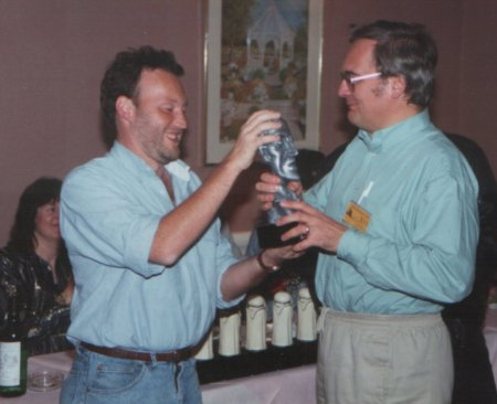 Stephen Jones presents Ramsey Campbell with his World Fantasy Award for BEST NEW HORROR VOLUME ONE at Fantasycon XVI, London, 1991