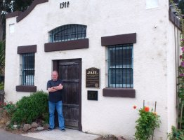Stephen Jones outside Davenport CA's 1914 Jailhouse